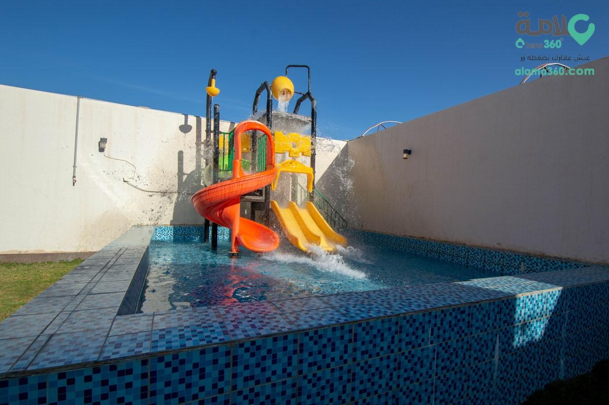 شاليه بالعاب مائية وغرفة معيشة شمال الرياض حي الرمال الر ياض